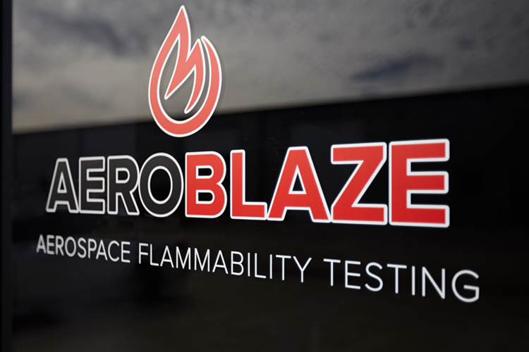 Aerospace flammability testing logo on front door