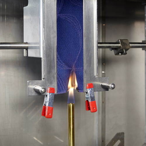 Aircraft interior flammability test for various interior materials (vertical burn)